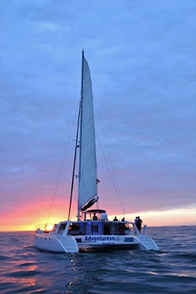 Adventuress yacht at San Diego sunset